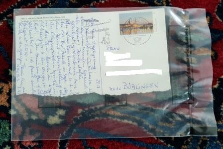 beschädigte Postkarte