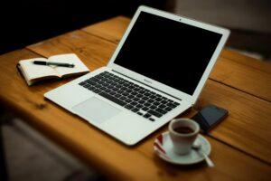MacBook Air on brown wooden table